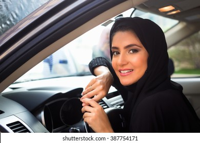 Smiling Arab Women inside a car