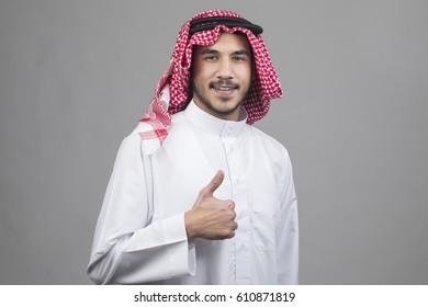 Smiling Arabian businessman, success concept