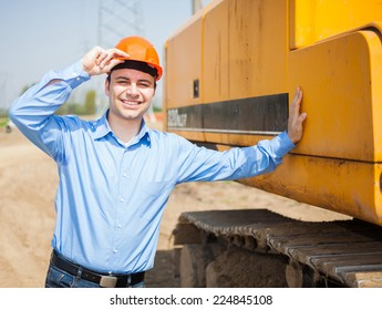 Smiling architect in a construction site