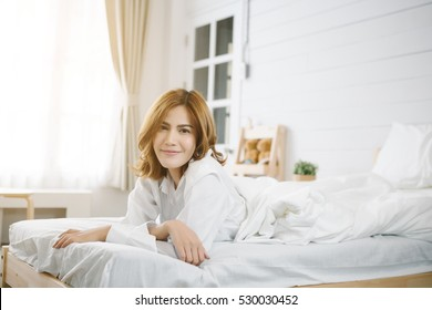 Smiling Asia women on Bed.