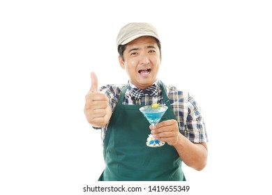 Smiling Asian baker isolated on white background.