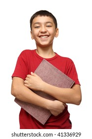 smiling asian boy holding big book isolated on white