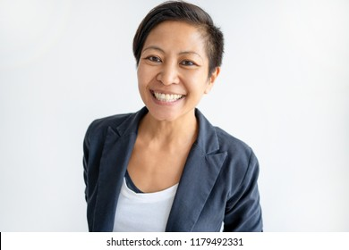 Smiling Asian business woman looking at camera. Young lady. Asian business lady concept. Isolated front view on white background.