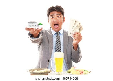 Smiling Asian businessman with money