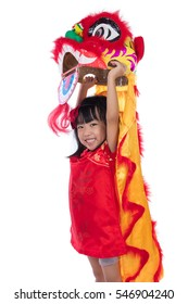 Smiling Asian Chinese little girl with Lion Dance costume celebrating Chinese New Year in isolated white background.