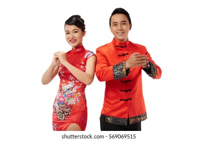 Smiling Asian couple making hand gesture to congratulate with Chinese New Year