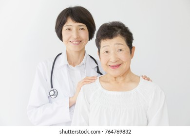 smiling the Asian doctor and the aged person