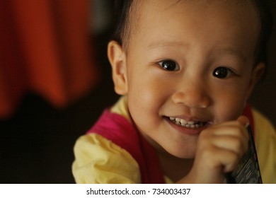 a smiling Asian girl.