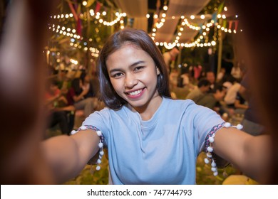 smiling asian girl selfie while cerebration party