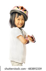 smiling asian little girl in protective roller gear on white background