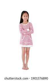 Smiling asian little kid girl with long hair crossed arms and standing isolated on white background. Full length