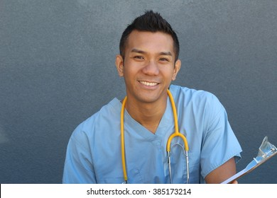 Smiling Asian male nurse with copy space on the left