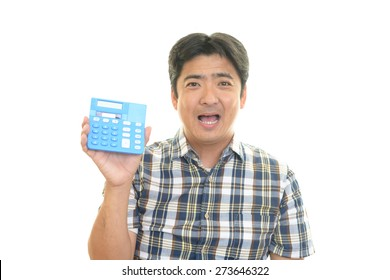 Smiling Asian man with calculator