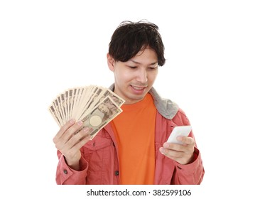 Smiling Asian man with money