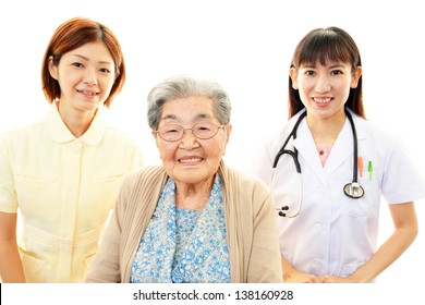 Smiling Asian medical staff and senior woman