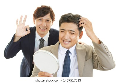 Smiling Asian men isolated on white background.