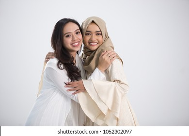 Smiling asian muslim bestfriend in front of camera. eid mubarak concept