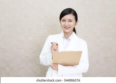 Smiling Asian pharmacist