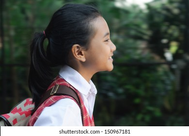 smiling asian schoolgirl with ponytail