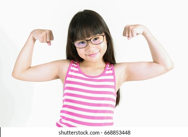 Smiling  asian teenage girl showing muscles isolated on white background (strength, health, sport, fitness concept)