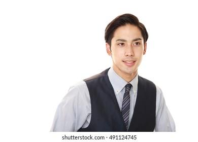 Smiling Asian waiter