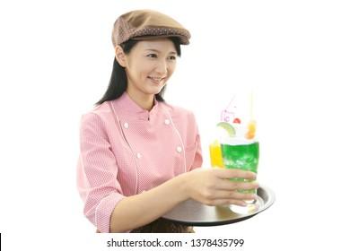Smiling Asian waitress isolated on white background.