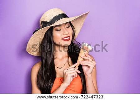 67670f3be6841 smiling asian woman in beach attire holding an ice-cream cone in her hands  and