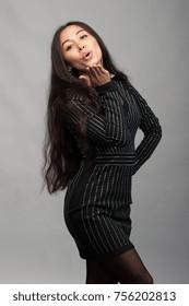 Smiling asian woman in black dress