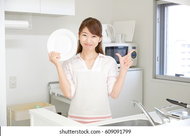 smiling Asian woman check mark gesture