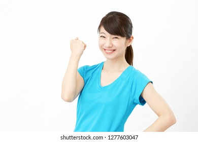 smiling Asian woman guts pose gesture