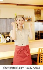 smiling Asian woman guts pose gesture