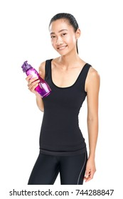 Smiling asian woman holding bottle of water. Fitness girl in black sportswear standing with sipper plastic bottle. Isolated photo of female young sporty model