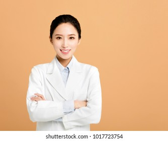 Smiling asian woman pharmacist doctor isolated