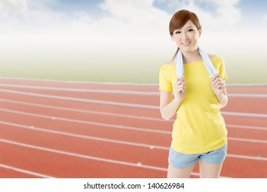 Smiling athletic woman take a rest after training, closeup portrait in outdoor sport field.