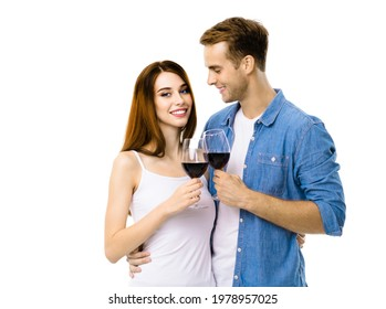 Smiling attractive amorous couple drinking red wine. Portrait image of caucasian models with redwine glasses in love studio concept, isolated on white background. Man and woman together. Valentines.