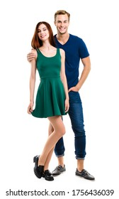 Smiling attractive amorous couple. Full body length portrait image of standing close and looking at camera models at happy in love studio concept, isolated over white background. Man and woman posing.