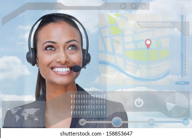Smiling attractive businesswoman looking at futuristic interface hologram in bright office