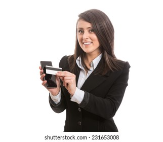 Smiling attractive elegant woman paying with smart phone