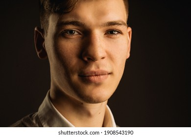 smiling attractive guy on a dark background