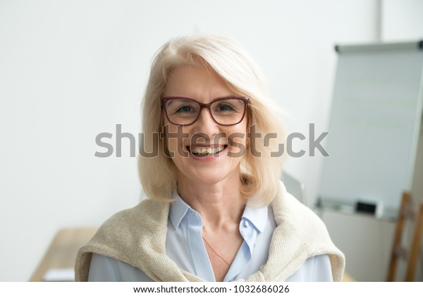 Smiling attractive senior businesswoman wearing glasses head shot, happy aged teacher, successful woman company boss, older female executive, mature lady professional looking at camera, portrait