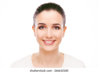 Smiling attractive woman with radiant fresh face skin posing on white background
