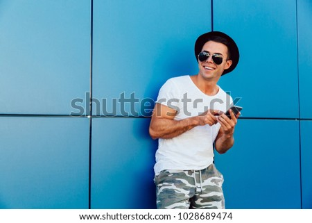 b1fa4e54b7bd Smiling Attractive Young Man Cell Phone Stock Photo (Edit Now ...