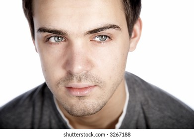 smiling attractive young man on plain background