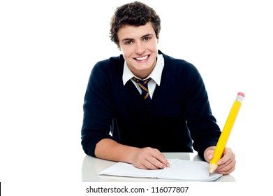 Smiling attractive youngster kid studying isolated over white background