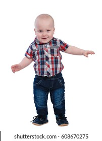 Smiling baby boy in plaid shirt and blue jeans isolated on white