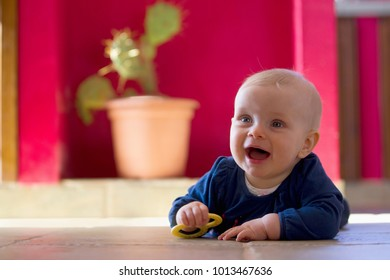 Smiling baby crawling on floor