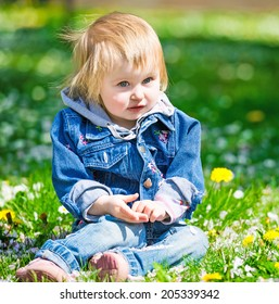 Smiling baby in field of flowers