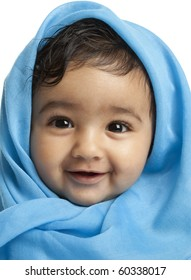 Smiling Baby Girl Draped in Blue Blanket