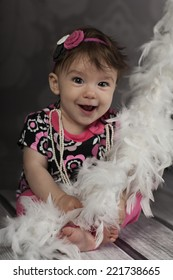 Smiling Baby Girl with voile feather and chaplet