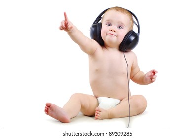 Smiling baby with headphone over white background